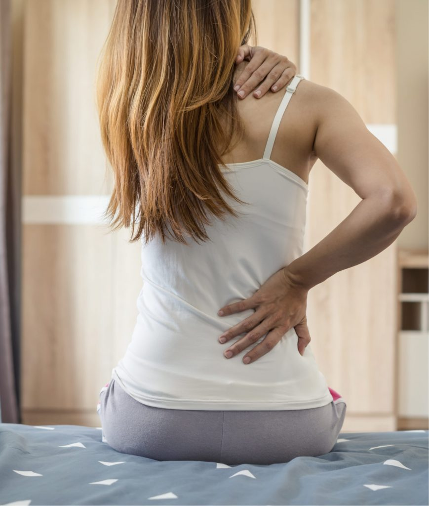 Woman with back and shoulder pain